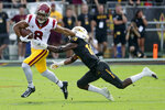 Southern California wide receiver Amon-Ra St. Brown (8) eludes the tackle of Arizona State safety Cam Phillips (15) during the first half of an NCAA college football game, Saturday, Nov. 9, 2019, in Tempe, Ariz. (AP Photo/Matt York)