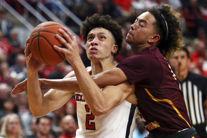 Texas Tech's Clarence Nadolny (2) drives through contact during the first half of an NCAA college basketball game against Bethune-Cookman, Saturday, Nov. 9, 2019, in Lubbock, Texas. (Sam Grenadier/Lubbock Avalanche-Journal via AP)