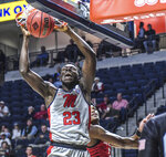 Mississippi forward Sammy Hunter (23) dunks next to Seattle guard Morgan Means (13) during an NCAA college basketball game Tuesday, Nov. 19, 2019, in Oxford, Miss. (Bruce Newman/The Oxford Eagle via AP)