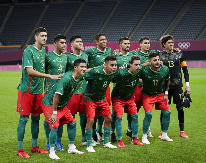 Mexico's team players pose for a photo prior a men's soccer match against South Africa at the 2020 Summer Olympics, Wednesday, July 28, 2021, in Sapporo, Japan. (AP Photo/Silvia Izquierdo)