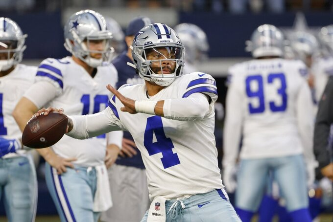 Dallas Cowboys quarterback Dak Prescott (4) warms up before an NFL football game against the Philadelphia Eagles in Arlington, Texas, Monday, Sept. 27, 2021. (AP Photo/Ron Jenkins)