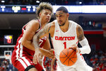 Dayton's Obi Toppin (1) drives against Massachusetts' Tre Mitchell, left, during the first half of an NCAA college basketball game, Saturday, Jan. 11, 2020, in Dayton. (AP Photo/John Minchillo)