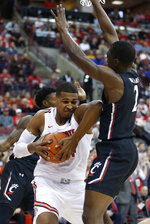 Ohio State's Kaleb Wesson, left, grabs a rebound away from Cincinnati's Keith Williams during the first half of an NCAA college basketball game Wednesday, Nov. 6, 2019, in Columbus, Ohio. (AP Photo/Jay LaPrete)