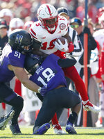 Nebraska's Mike Williams (19) is tackled by Northwestern's Blake Gallagher (51) and Northwestern's Cameron Ruiz during the first half of an NCAA college football game Saturday, Oct. 13, 2018, in Evanston, Ill.. (AP Photo/Jim Young)