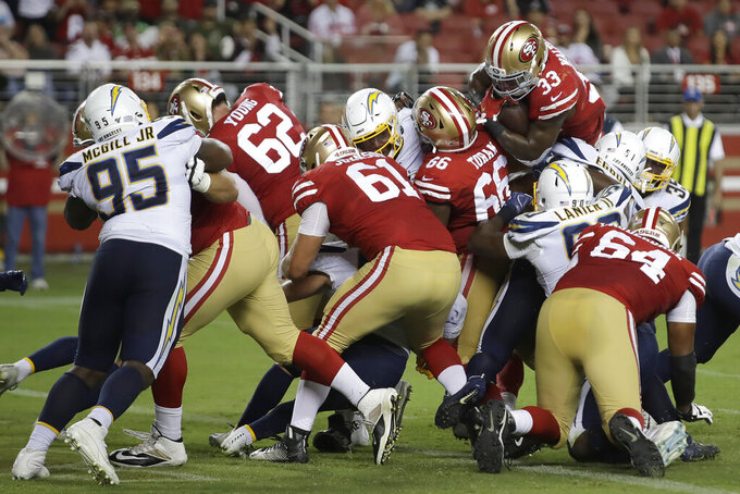 San Francisco 49ers running back Austin Walter (33) scores against the Los Angeles Chargers during the second half of an NFL preseason football game in Santa Clara, Calif., Thursday, Aug. 29, 2019. (AP Photo/Ben Margot)