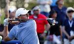 Rory McIlroy, of Northern Ireland, hits his tee shot on the 18th hole during the second round of The Players Championship golf tournament Friday, March 15, 2019, in Ponte Vedra Beach, Fla. (AP Photo/Gerald Herbert)