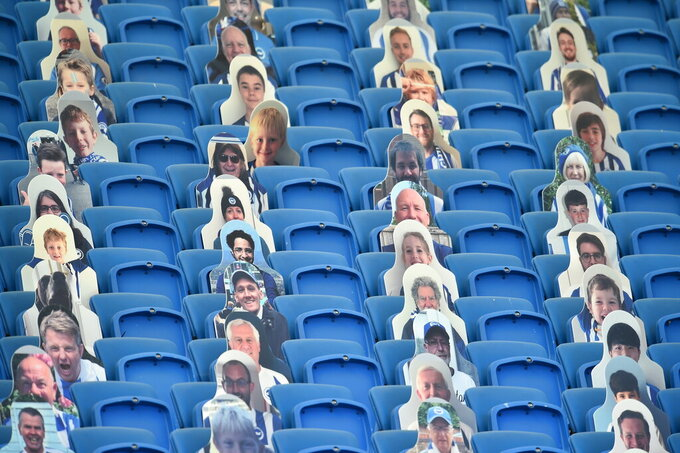 Cutout photos of Brighton fans fill the empty stands during the English Premier League soccer match between Brighton and Newcastle United at the American Express Community Stadium in Brighton, England, Monday, July 20, 2020. (Glyn Kirk/Pool via AP)