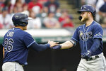 Tampa Bay Rays' Austin Meadows, right, is congratulated by Ji-Man Choi after Meadows hit a two-run home run during the third inning of the team's baseball game against the Cleveland Indians, Saturday, July 24, 2021, in Cleveland. (AP Photo/Tony Dejak)