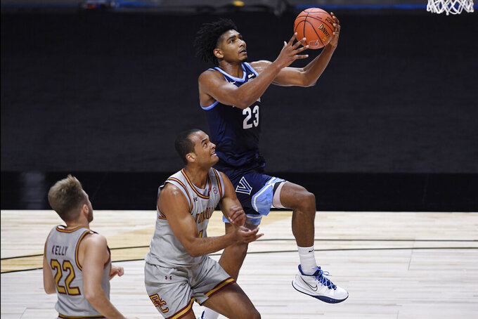 Villanova's Jermaine Samuels goes up to the basket as Boston College's Steffon Mitchell, center, defends during the first half of an NCAA college basketball game Wednesday, Nov. 25, 2020, in Uncasville, Conn. (AP Photo/Jessica Hill)