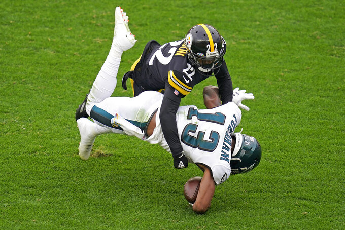 Philadelphia Eagles wide receiver Travis Fulgham (13) is tackled by Pittsburgh Steelers cornerback Steven Nelson (22) during the first half of an NFL football game, Sunday, Oct. 11, 2020, in Pittsburgh. (AP Photo/Keith Srakocic)
