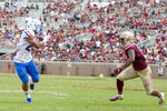 Boise State wide receiver Khyheem Waleed (23) makes a catch in front of Florida State defensive back Jaiden Lars-Woodbey (6) in the second half of an NCAA college football game in Tallahassee, Fla., Saturday, Aug. 31, 2019. Boise State defeated Florida State 36-31. (AP Photo/Mark Wallheiser)