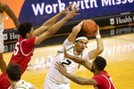 Missouri's Drew Buggs, center, passes past Bradley's Elijah Childs, right, and Darius Hannah, left, during the second half of an NCAA college basketball game Tuesday, Dec. 22, 2020, in Columbia, Mo. (AP Photo/L.G. Patterson)