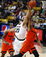 Colorado forward Lucas Siewert, left, blocks a shot by Oregon State guard Stephen Thompson Jr. who drives to the rim in the first half of an NCAA college basketball game Thursday, Jan. 31, 2019, in Boulder, Colo. (AP Photo/David Zalubowski)
