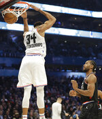 Team Giannis' Giannis Antetokounmpo, of the Milwaukee Bucks, dunks the ball against Team LeBron during the first half of an NBA All-Star basketball game, Sunday, Feb. 17, 2019, in Charlotte, N.C. (AP Photo/Chuck Burton)