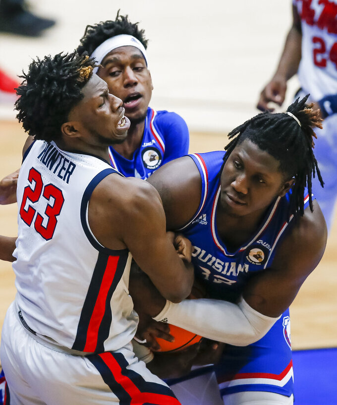 Mississippi forward Sammy Hunter (23) battles Louisiana Tech forward Andrew Gordon, right, and guard JaColby Pemberton, background, for the ball during the second half of an NCAA college basketball game in the NIT, Friday, March 19, 2021, in Frisco, Texas. Hunter was charged with a technical foul after the play for shoving Gordon. (AP Photo/Brandon Wade)