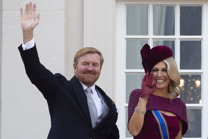 FILE - In this Tuesday, Sept. 17, 2019 file photo, Dutch King Willem-Alexander and Queen Maxima wave from the balcony of royal palace Noordeinde in The Hague, Netherlands. The Dutch king issued a video message Wednesday saying