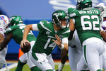 New York Jets quarterback Sam Darnold (14) moves out of the pocket during the first half of an NFL football game against the Buffalo Bills in Orchard Park, N.Y., Sunday, Sept. 13, 2020. (AP Photo/Jeffrey T. Barnes)