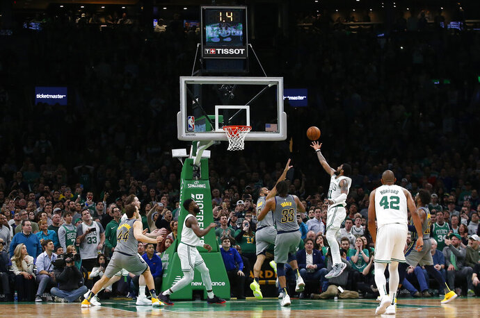 Boston Celtics' Kyrie Irving makes the game-winning shot in the final seconds of the team's 114-112 win over the Indiana Pacers during an NBA basketball game Friday, March 29, 2019, in Boston. (AP Photo/Winslow Townson)