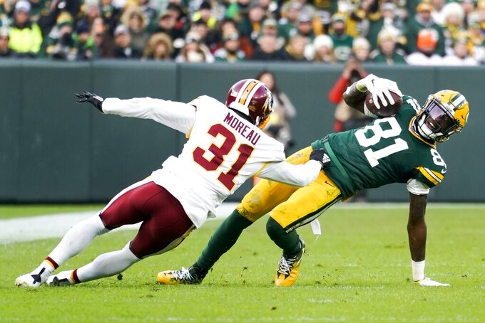 Washington Redskins' Fabian Moreau stops Green Bay Packers' Geronimo Allison after a catch during the second half of an NFL football game Sunday, Dec. 8, 2019, in Green Bay, Wis. (AP Photo/Morry Gash)