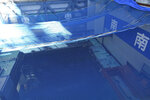 FILE - In this Jan. 25, 2018, file photo,a cooling pool where a total of mostly used 566 sets of fuel rods are stored underwater and covered by a protective net, waits to be removed in a step to empty the pool at Unit 3 of the Fukushima Dai-ichi nuclear power plantahead ofa fuel removal from its storage poolin Okuma, Fukushima Prefecture, northeast Japan. Japan revised a roadmap on Friday, Dec. 27, 2019, for the tsunami-wrecked Fukushima nuclear plant cleanup, further delaying the removal of thousands of spent fuel units that remain in cooling pools since the 2011 disaster. More than 4,700 units of fuel rods remain inside the three melted reactors and two others that survived the 2011 earthquake and tsunami. (AP Photo/Mari Yamaguchi, File)