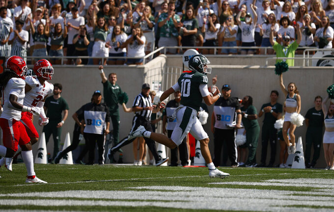 Michigan State quarterback Payton Thorne (10) runs for a touchdown against Youngstown State during the first quarter of an NCAA college football game, Saturday, Sept. 11, 2021, in East Lansing, Mich. (AP Photo/Al Goldis)