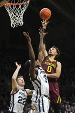 Minnesota guard Payton Willis (0) shoots over Butler guard Kamar Baldwin (3) in the second half of an NCAA college basketball game in Indianapolis, Tuesday, Nov. 12, 2019. Butler won 64-56. (AP Photo/AJ Mast)