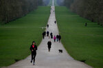 People walk the Long Walk in front of Windsor Castle, near the Frogmore Cottage home of Britain's Prince Harry and Meghan Duchess of Sussex in Windsor, Friday, Jan. 10, 2020. Britain's Prince Harry and his wife, Meghan, said they are planning