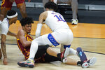 USC forward Max Agbonkpolo (23) and Kansas forward Jalen Wilson (10) battle for a loose ball during the first half of a men's college basketball game in the second round of the NCAA tournament at Hinkle Fieldhouse in Indianapolis, Monday, March 22, 2021. (AP Photo/Paul Sancya)