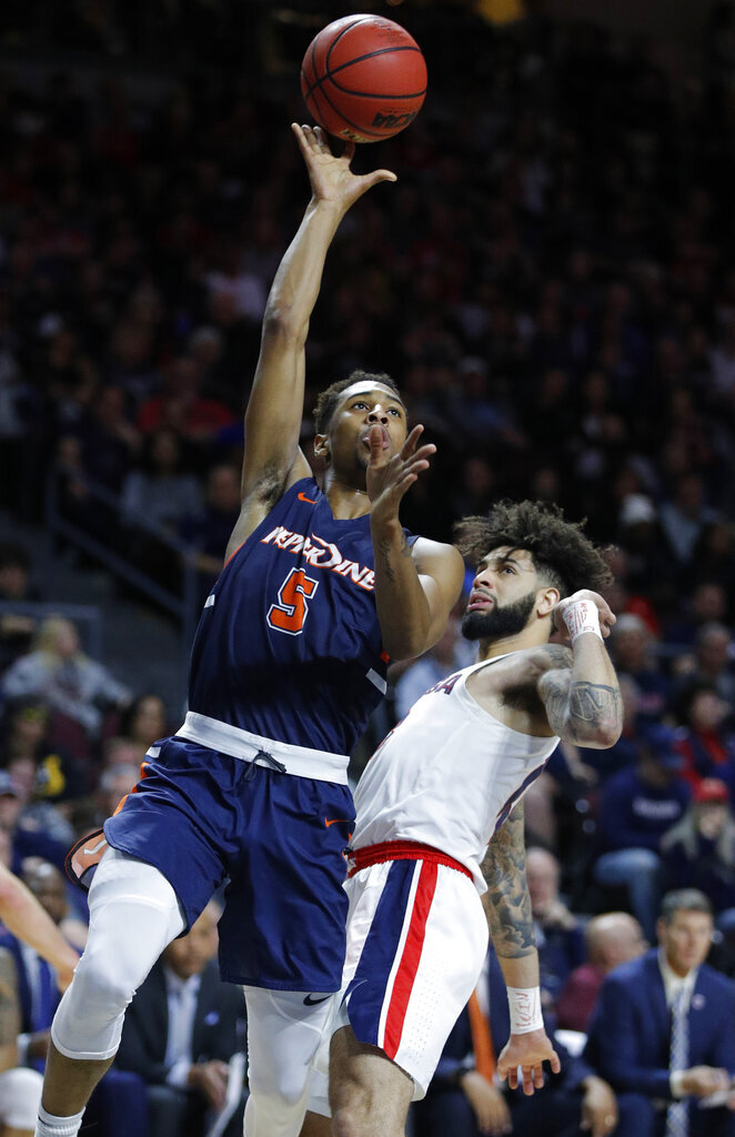 Pepperdine's Jade' Smith (5) shoots around Gonzaga's Josh Perkins during the second half of an NCAA semifinal college basketball game at the West Coast Conference tournament, Monday, March 11, 2019, in Las Vegas. (AP Photo/John Locher)