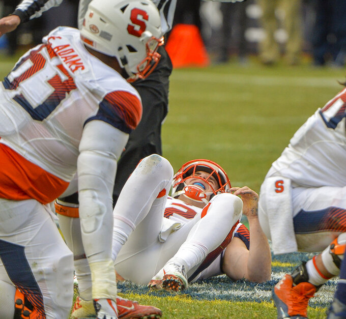 Syracuse quarterback Eric Dungey (2) lies on the ground injured during the first half of an NCAA college football game against Notre Dame, Saturday, Nov. 17, 2018, at Yankee Stadium in New York. (AP Photo/Howard Simmons)