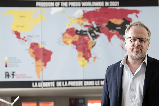 "Christophe Deloire, head of RSF (Reporters without borders) stands in front of the 2021 map of press freedom in Paris, France, Tuesday April, 20, 2021. Reporters Without Borders says there has been a ""dramatic deterioration"" of press freedom since the pandemic tore across the world. Its new World Press Freedom Index evaluated the media in 180 countries and painted a stark picture. The group says in its annual report that 73% of nations have serious issues with media freedom. It says countries have used the pandemic ""as grounds to block journalists' access to information, sources and reporting in the field."" The media watchdog says it is particularly true for governments in Asia, the Mideast and Europe. (AP Photo/Lewis Joly)"