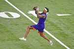 Clemson football player Diondre Overton catches a pass while running drills during NFL Pro Day Thursday, March 12, 2020, in Clemson, S.C. (AP Photo/Richard Shiro)