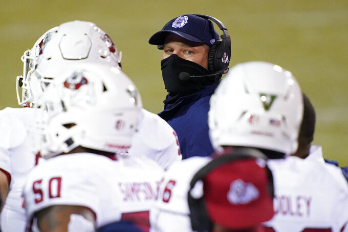 Fresno State head coach Kalen DeBoer speaks with players during the second half of an NCAA college football game against New Mexico, Saturday, Dec. 12, 2020, in Las Vegas. (AP Photo/John Locher)