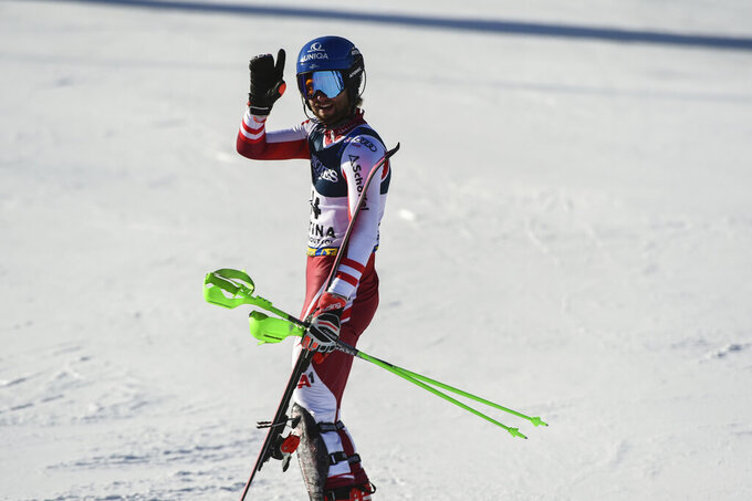 Austria's Marco Schwarz waves after crossing the finish line during the slalom portion of the men's combined race, at the alpine ski World Championships, in Cortina d'Ampezzo, Italy, Monday, Feb. 15, 2021. (AP Photo/Marco Tacca)