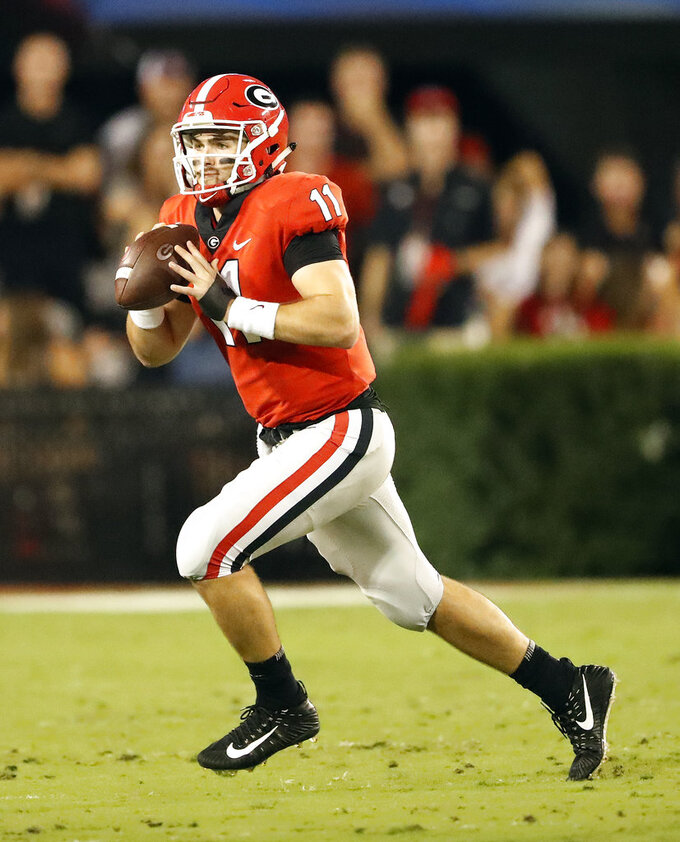 FILE - In this Oct. 6, 2018, file photo, Georgia quarterback Jake Fromm (11) is shown against Vanderbilt during the first half of an NCAA college football game, in Atlanta, Ga. No. 7 Georgia plays at No. 9 Florida on Saturday.  (AP Photo/John Bazemore, File)