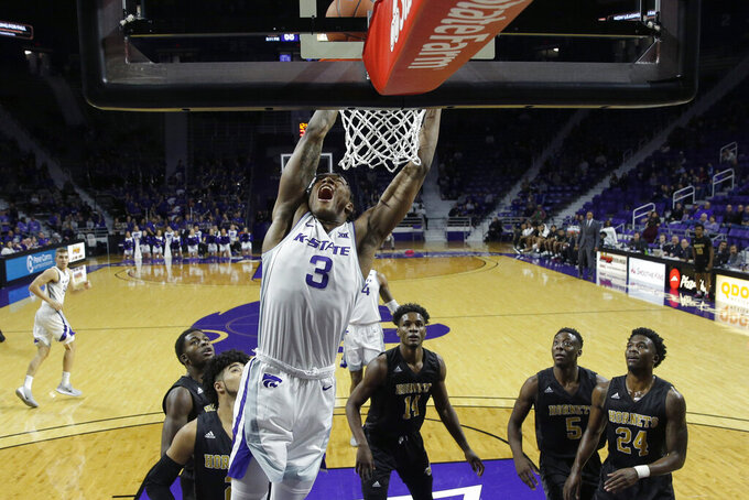 Kansas State's DaJuan Gordon (3) dunks the ball during the second half of an NCAA college basketball game against Alabama State Wednesday, Dec. 11, 2019, in Manhattan, Kan. (AP Photo/Charlie Riedel)