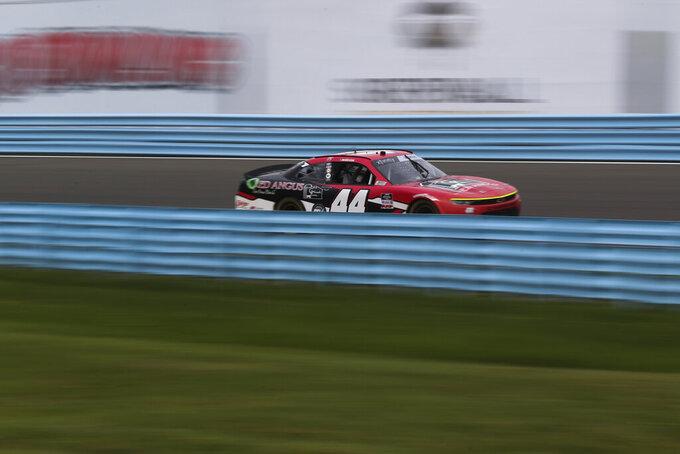 Tommy Joe Martins drives along the Esses in the NASCAR Xfinity Series auto race at Watkins Glen International in Watkins Glen, N.Y., on Saturday, Aug. 7, 2021. (AP Photo/Joshua Bessex)