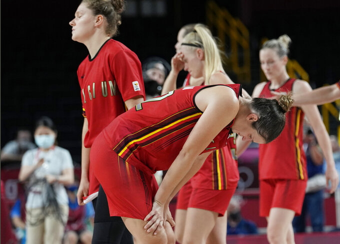 Belgium players half off of the court after their loss to Japan in a women's basketball quarterfinal game at the 2020 Summer Olympics, Wednesday, Aug. 4, 2021, in Saitama, Japan. (AP Photo/Eric Gay)