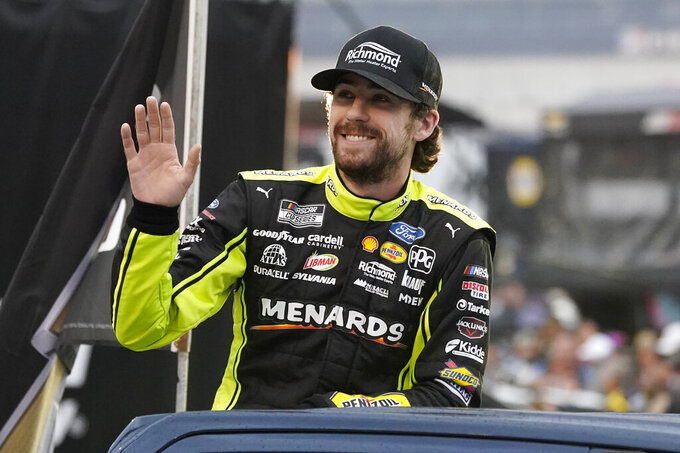 Ryan Blaney waves to fans before a NASCAR Cup Series auto race at Bristol Motor Speedway Saturday, Sept. 18, 2021, in Bristol, Tenn. (AP Photo/Mark Humphrey)
