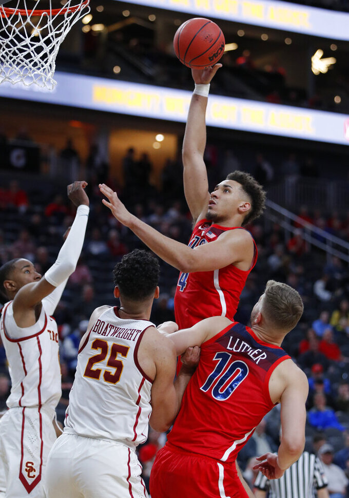 Arizona's Chase Jeter shoots against Southern California during the second half of an NCAA college basketball game in the first round of the Pac-12 men's tournament, Wednesday, March 13, 2019, in Las Vegas. (AP Photo/John Locher)