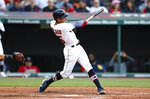 Cleveland Indians' Oscar Mercado hits a triple off Houston Astros starting pitcher Lance McCullers Jr. during the second inning of a baseball game Friday, July 2, 2021, in Cleveland. (AP Photo/Ron Schwane)