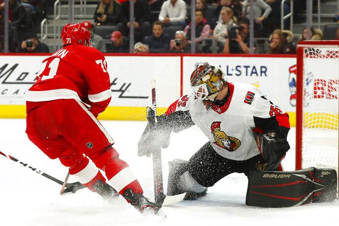 Detroit Red Wings center Dylan Larkin (71) scores against Ottawa Senators goaltender Marcus Hogberg (35) in the second period of an NHL hockey game Friday, Jan. 10, 2020, in Detroit. (AP Photo/Paul Sancya)