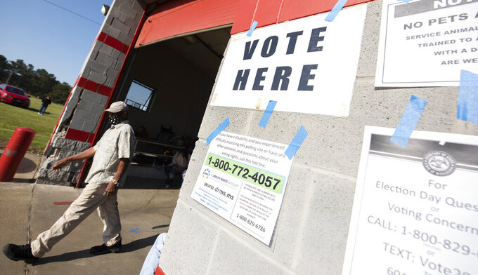 Roosevelt Brown, of Jackson, Miss., leaves Precinct 85 at Fire Station 26 in Jackson, Miss., after voting in the citywide primary elections, Tuesday, April 6, 2021. Winners for Jackson mayor and city council will advance to either runoffs or the city's June 8 general election. (Barbara Gauntt/The Clarion-Ledger via AP)