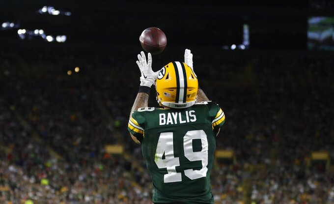 Green Bay Packers' Evan Baylis catches a touchdown pass during the first half of a preseason NFL football game against the Kansas City Chiefs Thursday, Aug. 29, 2019, in Green Bay, Wis. (AP Photo/Matt Ludtke)