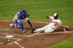 Kansas City Royals catcher Salvador Perez, left, tags out Baltimore Orioles' Pedro Severino who was attempting to score on a single by Jahmai Jones during the second inning of a baseball game, Thursday, Sept. 9, 2021, in Baltimore. (AP Photo/Julio Cortez)