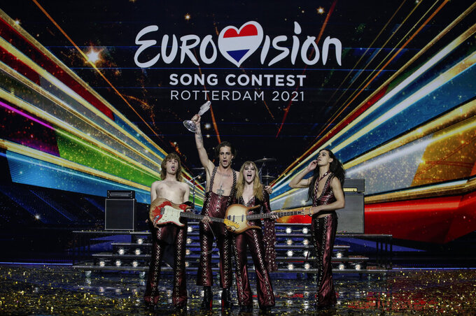 Maneskin from Italy celebrate with the trophy after winning the Grand Final of the Eurovision Song Contest at Ahoy arena in Rotterdam, Netherlands, Saturday, May 22, 2021. (AP Photo/Peter Dejong)