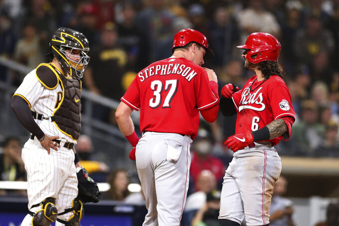 Cincinnati Reds' Jonathan India, right, celebrates with Tyler Stephenson (37) after hitting a two-run home run in the ninth inning of the team's baseball game against the San Diego Padres on Thursday, June 17, 2021, in San Diego. (AP Photo/Derrick Tuskan)