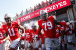 Ohio State players run onto the field before an NCAA college football game against Tulsa, Saturday, Sept. 18, 2021, in Columbus, Ohio. (AP Photo/Jay LaPrete)