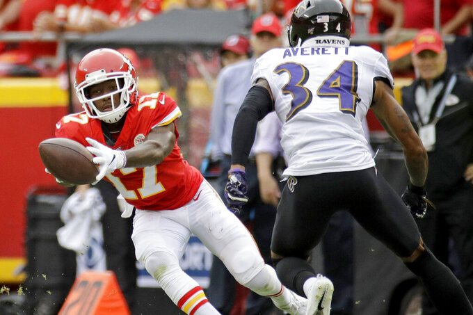 Kansas City Chiefs wide receiver Mecole Hardman (17) makes a catch in front of Baltimore Ravens cornerback Anthony Averett (34) during the first half of an NFL football game in Kansas City, Mo., Sunday, Sept. 22, 2019. (AP Photo/Charlie Riedel)