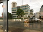 An entrance to the office building of the State Journal Register is seen, Tuesday, May 14, 2019, in Springfield, Ill. Illinois' capital-city newspaper, a 188-year-old institution tied intimately to Abraham Lincoln, is without a news chief after its editor resigned in hopes of sparing more layoffs, according to a staff writer. Angie Muhs served notice of her resignation on Friday, May 10. (AP Photo/John O'Connor)